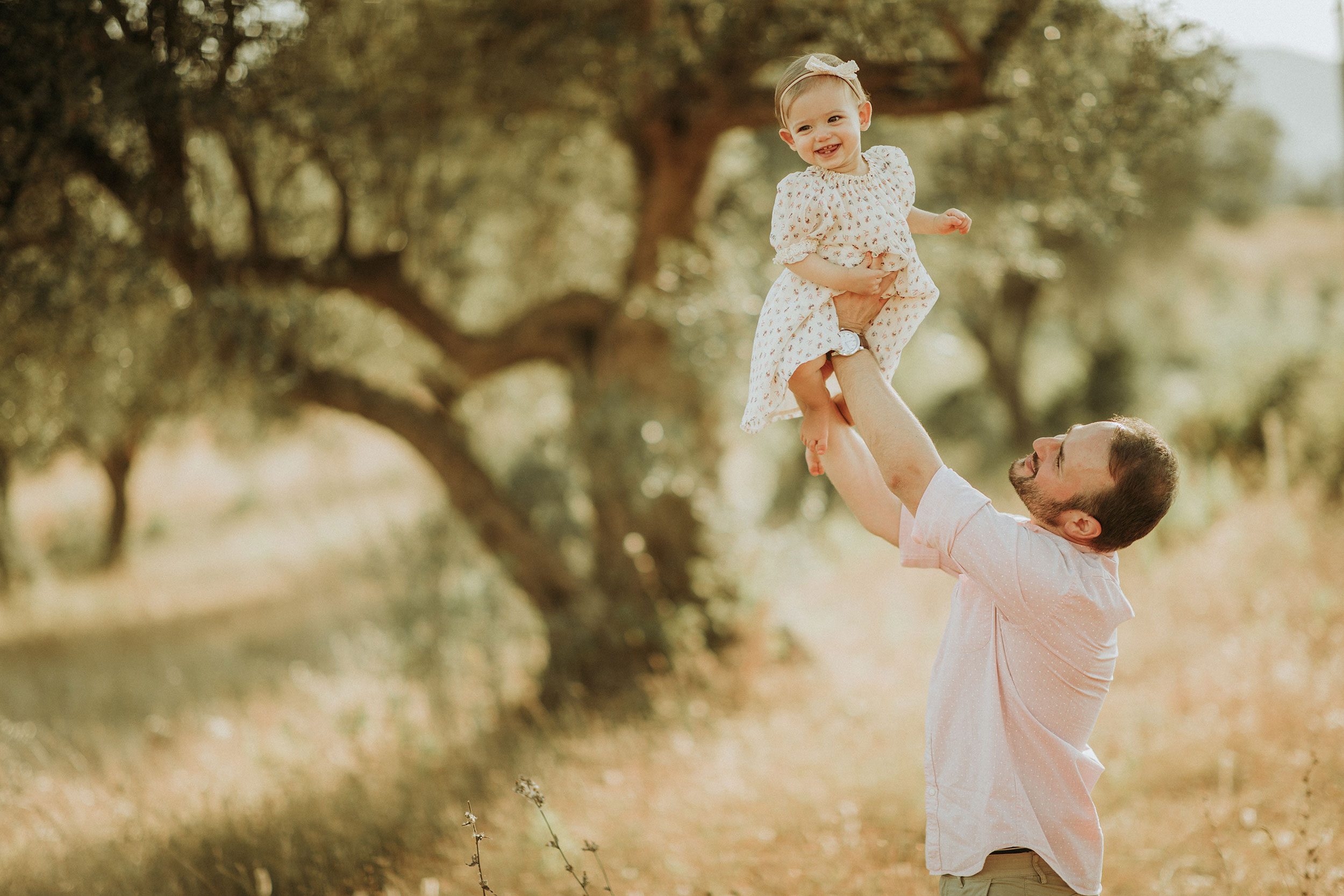 The father lifting his daughter up
